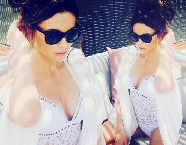 Kate Beckinsale wows in white as she soaks up the sun on holiday