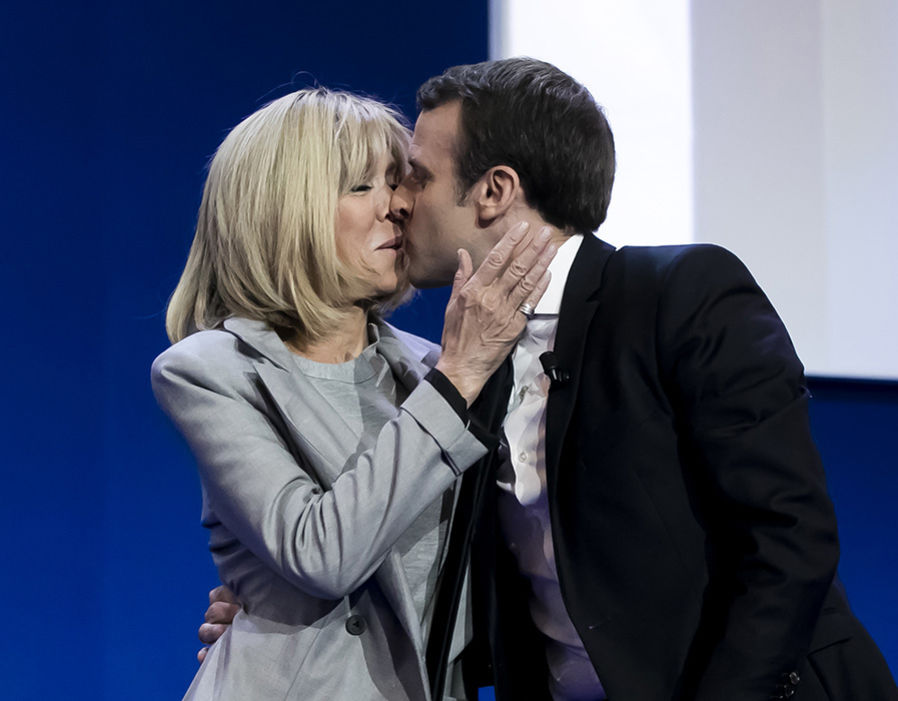 Emmanuel Macron with his wife Brigitte Trogneux, addresses activists after the announcement of the French presidential Election results on April 23, 2017 in Paris