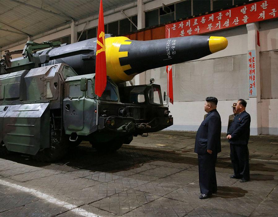 North Korean leader Kim Jong Un inspects the long-range strategic ballistic rocket Hwasong-12 (Mars-12)