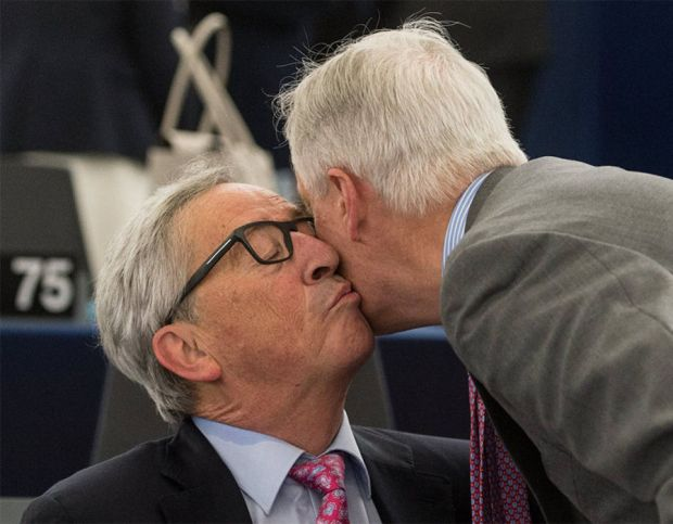 Jean-Claude Juncker, President of the European Commission, kisss Michel Barnier