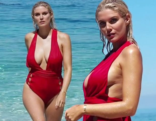 Ashley James smoulders in plunging red swimsuit
