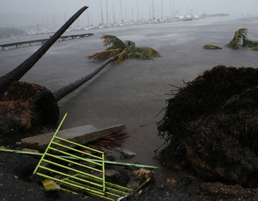 Debris is seen during a storm surge near the Puerto Chico Harbor during the passing of Hurricane Irma