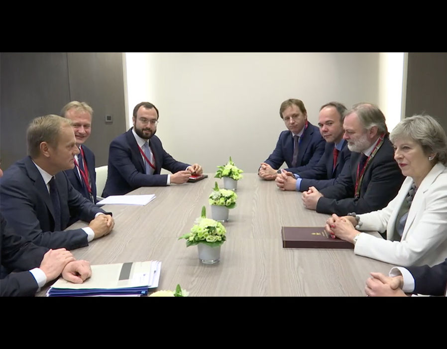 Theresa May sits across from Donald Tusk