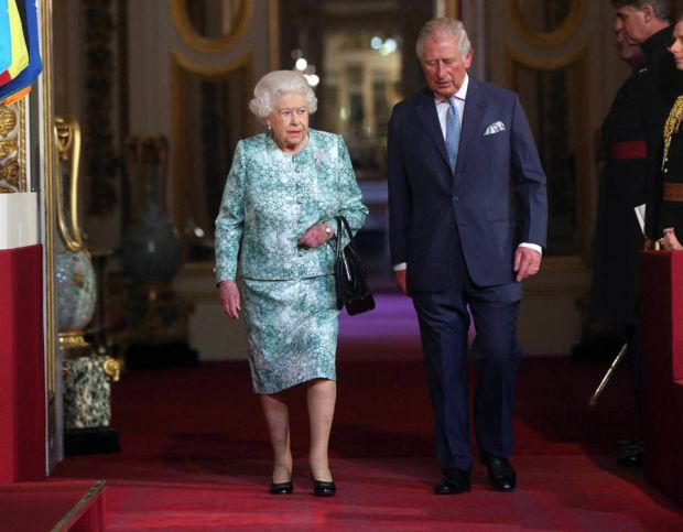 Queen Elizabeth II and the Prince of Wales arrive for the formal opening of the Commonwealth Heads of Government Meeting