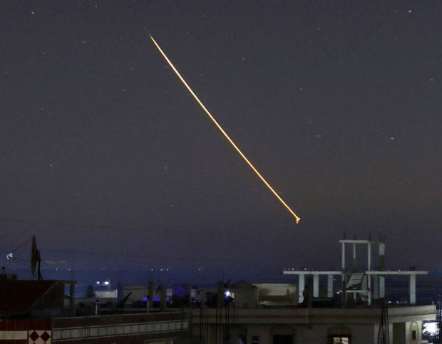 Missile fire is seen over Daraa