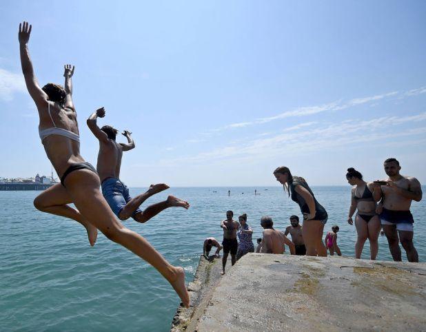 A group leap into the sea off Brighton Beach