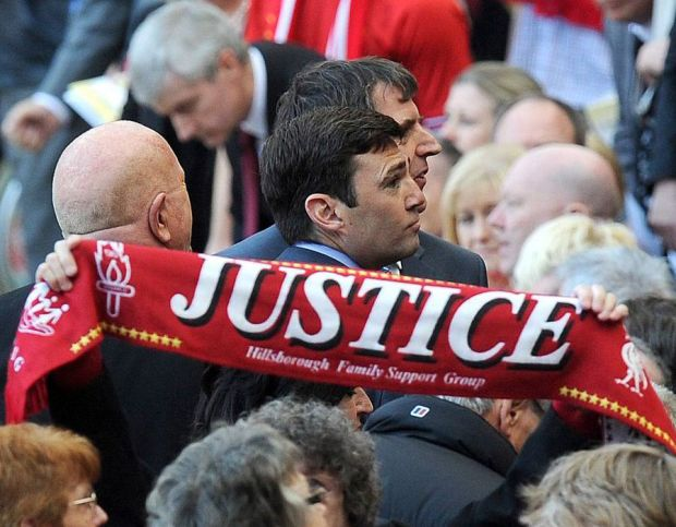 MP Andy Burnham takes his seat after his speach, during the Hillsborough 25th Anniversary Memorial Service at Anfield Stadium, Liverpool