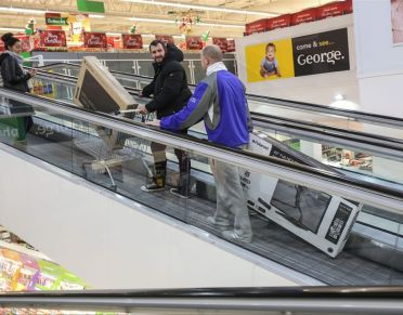 Picture shows shoppers rushing to buy cut price electrical goods at ASDA Pudsey store in Leeds hoping to get a bargain on Black Friday.