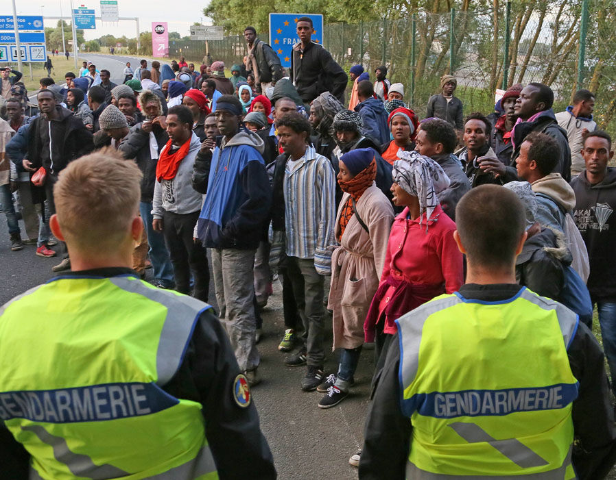 Migrants rush towards the channel tunnel in a bid to get into the UK