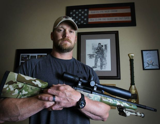Navy SEAL Chris Kyle holds a 308 sniper rifle at his home on 6 April 2012