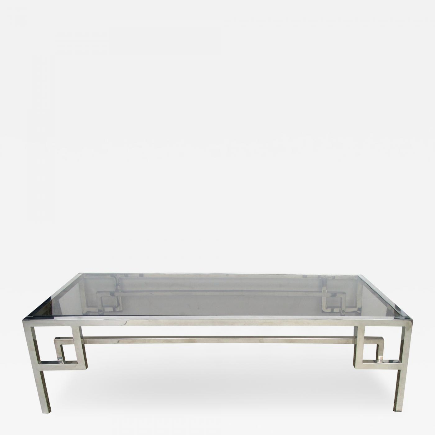 a modish french chrome and glass rectangular coffee table