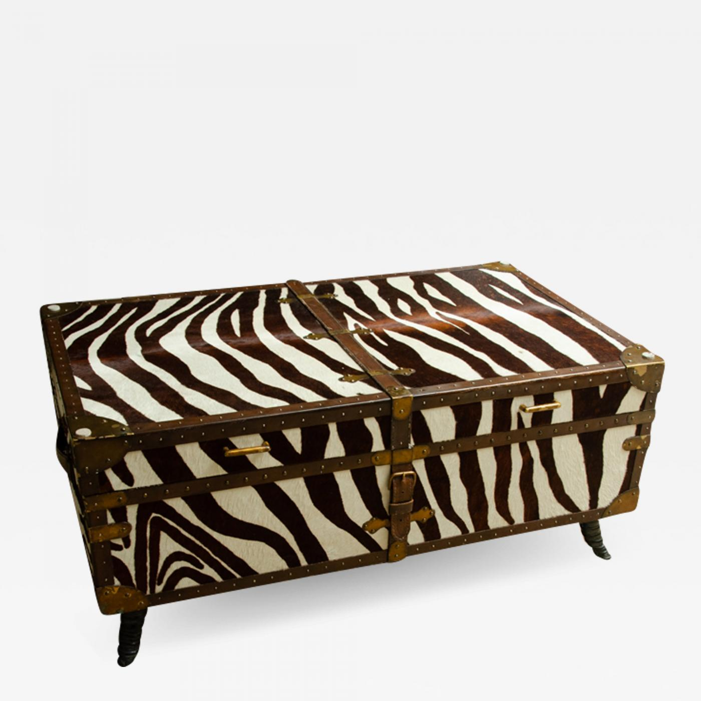french trunk cocktail table covered in zebra with glass top