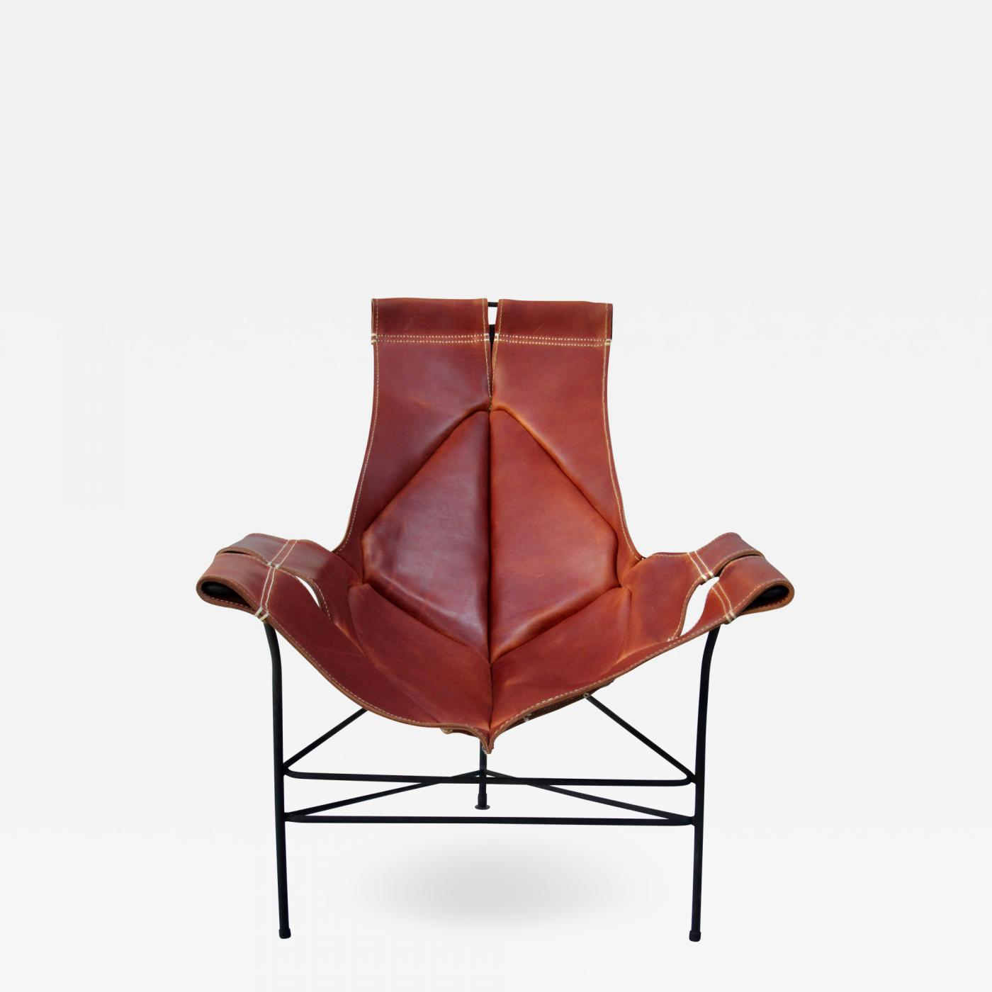 leather sling chairs sewing chair with storage wrought iron jerry johnson lounge for crafters 1960
