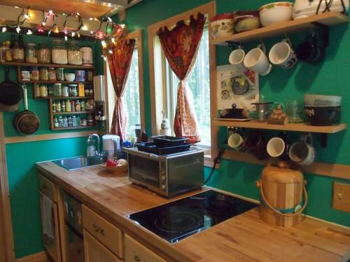 small resolution of a fully stocked kitchen in a tiny house