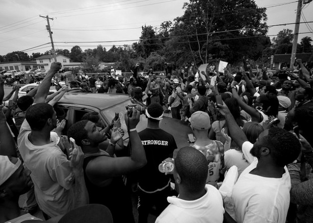 """Hands Up, Don't Shoot"": A rally in support of Michael Brown. Credit: Shawn Semmler/cc by 2.0"