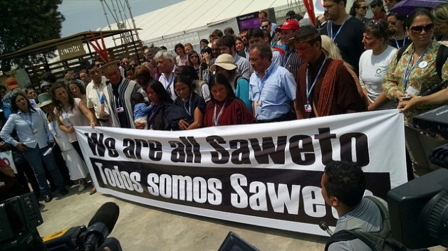 Widows of murdered leaders of the Asháninka community of Alto Tamaya Saweto of Peru and other indigenous rights activists raised their voices in protest at COP20 in Lima, demanding formal title to native lands. Credit: Milagros Salazar/IPS