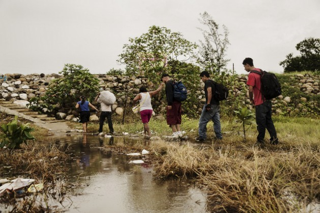 A group of Central American migrants walking along a trail in the southern Mexican state of Chiapas, on the border with Guatemala, at the start of their long journey across Mexico on their way to the United States. Credit: Courtesy Médecins Sans Frontières – Mexico