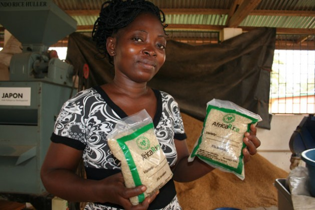 Research assistant Blance Soussous showing packed parboiled rice.  Credit: Busani Bufana/IPS