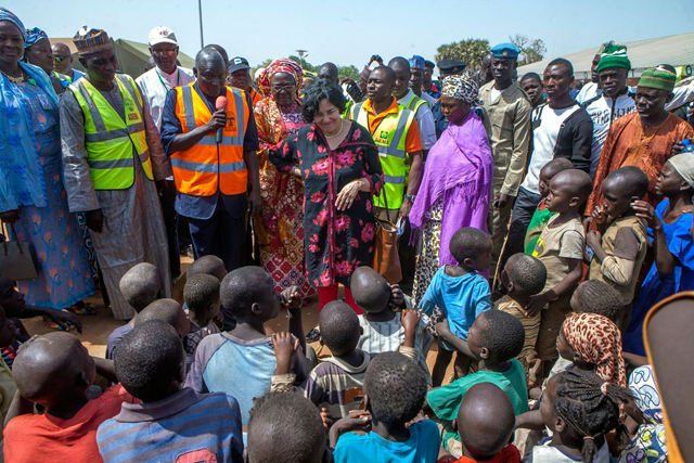 Special Representative of the Secretary-General for Children and Armed Conflict Leila Zerrougui (centre), meets displaced children and their families in northeastern Nigeria, in January 2015. Credit: UN