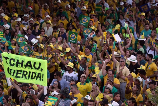 "Demonstrators supporting the removal of Brazilian President Dilma Rousseff celebrate Sunday Apr. 17 outside the lower house of Congress in Brasilia after it voted to impeach her. ""Chao querida"" (Bye-bye dear) reads one of the signs. Credit: Fábio Rodrigues Pozzebom/ Agência Brasil"