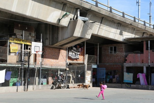 """Bajo Autopista"", a slum in the Villa 61 shantytown wedged under an expressway, just a few blocks from Retiro, one of the most upscale neighbourhoods in Buenos Aires. At least 111 million of Latin America's urban inhabitants live in slums. Credit: Fabiana Frayssinet/IPS"
