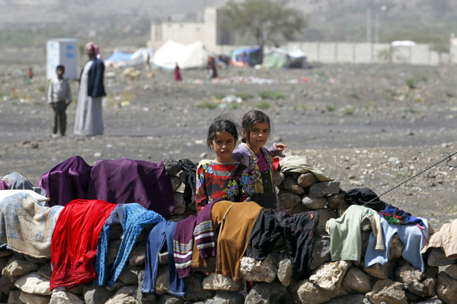 In Yemen, internally displaced children stand outside their family tent after the family fled their home in Saada province and found refuge in Darwin camp, in the northern province of Amran. Photo credit: UNHCR/Yahya Arhab