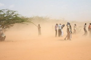 Famine refugees in East Africa are caught in a dust storm. Photo credit: flickr/Oxfam International