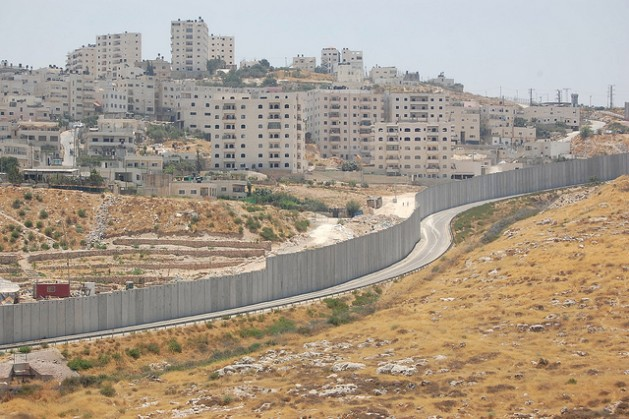 The Shuafat refugee camp can be seen across the separation wall from the Israeli settlement Pisgat Ze'ev. Credit: Jillian Kestler-D'Amours/IPS.