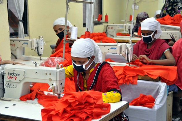 Garment workers in Bangladesh. Should Bangladeshis, Malaysians and others worry about their countries' downward slide in the 'Doing Business' ranking?  Credit: IPS