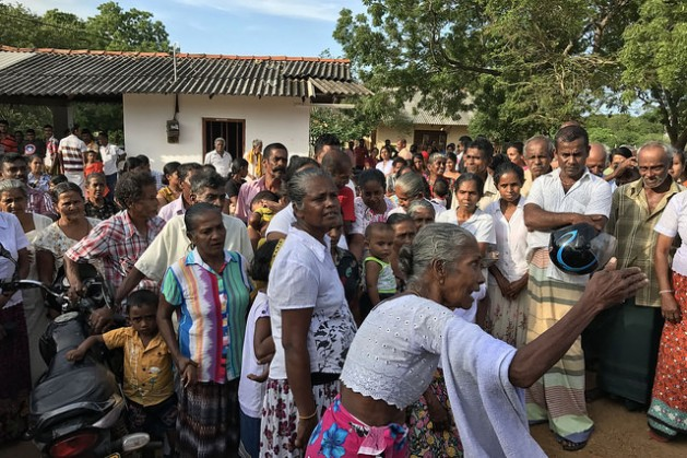 """Over our dead bodies."" Villagers in Beragama, Sri Lanka protest to prevent government surveyors from carrying out mapping due to fears of losing their land. Credit: Sanjana Hattotuwa/IPS"