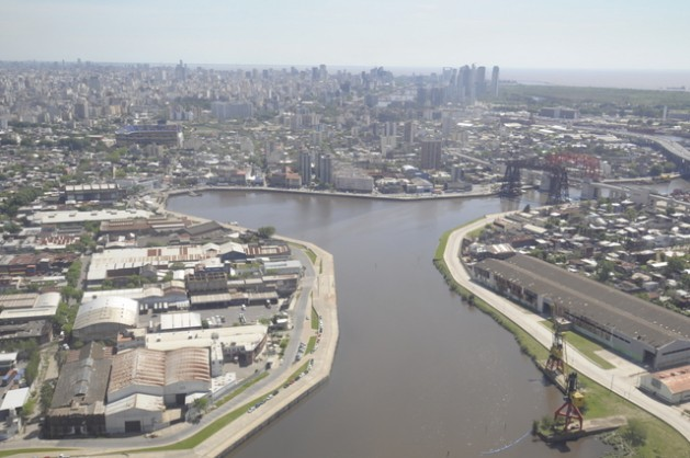 A view of Buenos Aires from the point where the Riachuelo flows into the Rio de la Plata. To the left can be seen the famous Boca Juniors stadium. Chronicles from 200 years ago were already talking about the pollution in the river. Credit: Courtesy of FARN