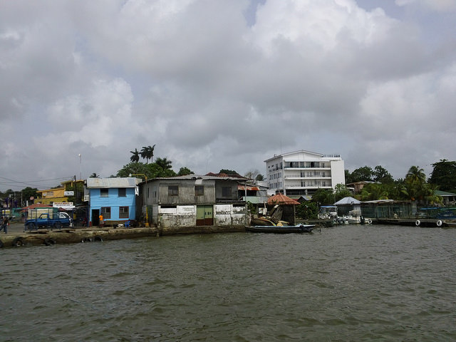 Part of the central region of the city of Bluefields, in Nicaragua's South Caribbean Autonomous Region, from the access pier to Bluefields lagoon, with buildings at the water's edge. The municipalities' urban and rural residents learned to raise their houses on pilings, among other measures to face the increasingly frequent floods. Credit: José Adán Silva/IPS