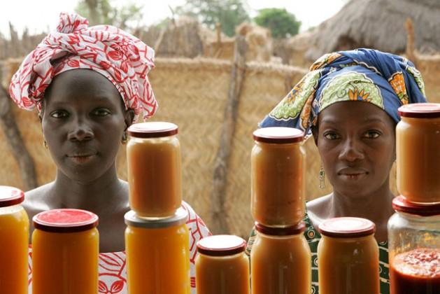 Rural women sell mango and sweet potato jam at the food processing shop in Bantantinnting, Senegal. Credit: UN Photo/Evan Schneider