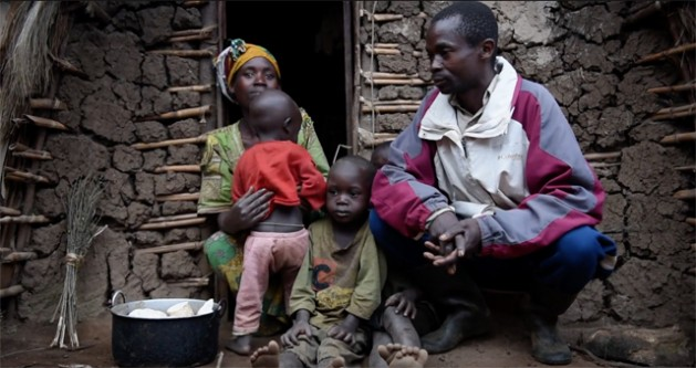 Saidi Olivier, a displaced farmer in North Kivu, Democratic Republic of the Congo (DRC) with his family in an IDP camp. Credit: IDMC