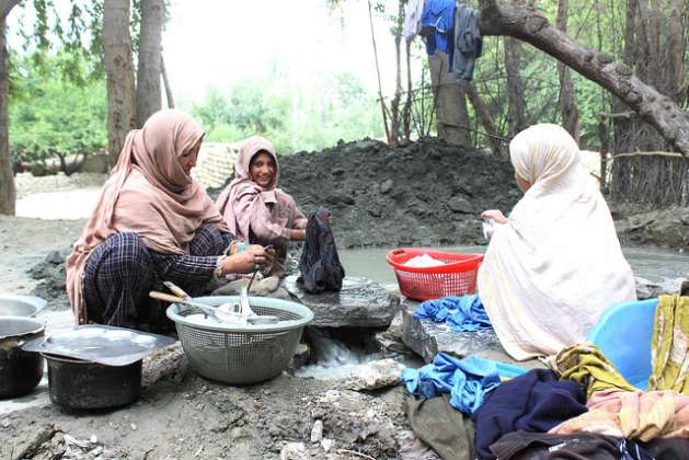 Women often bare the brunt of natural disasters since they are responsible for the upkeep of the household and the wellbeing of their families. Credit: Zofeen Ebrahim/IPS