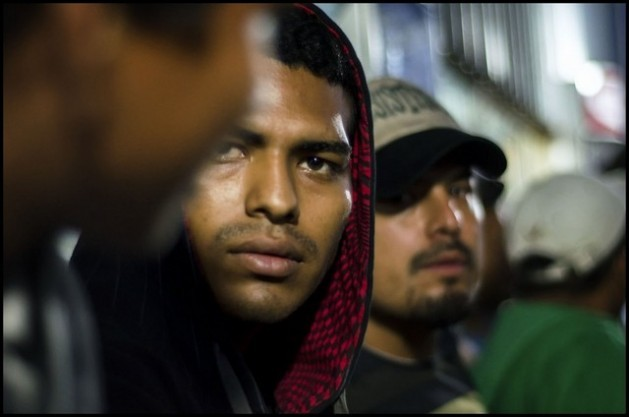 "Migrants with tired faces laden with the hardships of the hazardous journey from Central America to the United States rest in a shelter in Mexico, which many reach after being cheated by ""coyotes"" out of everything they had. Credit: Ximena Natera/ Pie de Página"