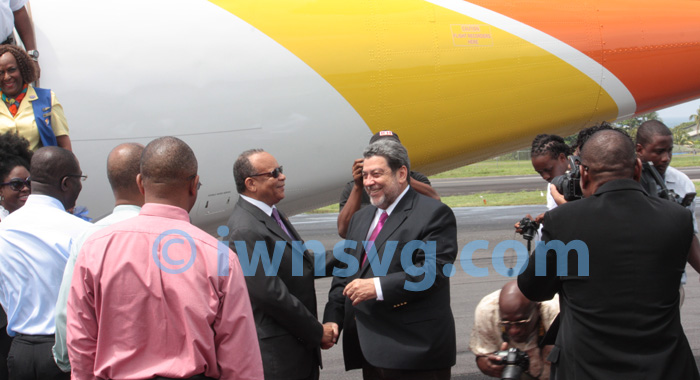 Prime Minister Dr. Ralph Gonsalves, Right, Greets Chair Of Liat'S Board Of Director, Dr. Jean Holder At E.t. Joshua Airport On Wednesday. (Iwn Photo)