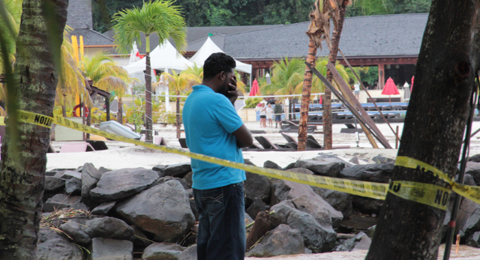Ricky Small Stands On The Beach Near Buccament Bay Resort Wednesday. His Wife, Joselle Small, Was Washed Away While On Her Way Home From Work At The Resort Tuesday Night. (Iwn Photo)