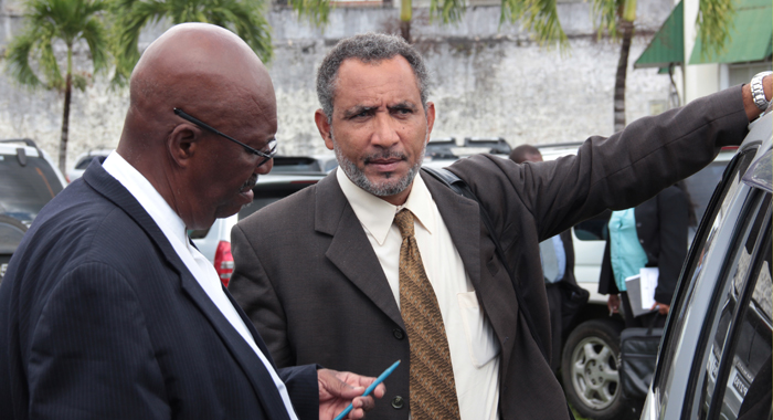 Opposition Leader Arnhim Eustace, Left, And Mp For Northern Grenadines Godwin Friday, Talk To Each Other After Walking Out Of Parliament On Tuesday.  (Iwn Photo)