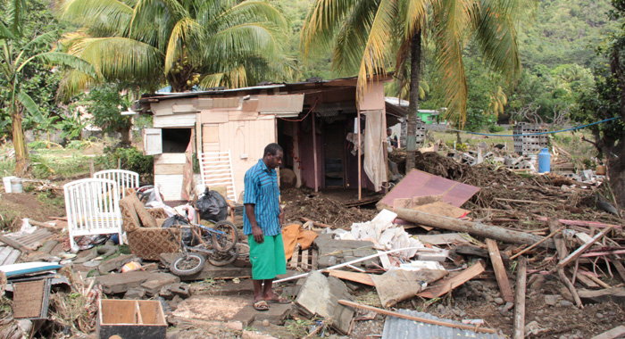 A Buccament Bay Resident Survey Damage After The Christmas Eve Trough System. (Iwn Photo)
