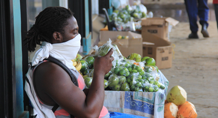 Vendor Delroy Nelson Used An Article Of Clothing To Protect Against The Dust.  (Iwn Photo)