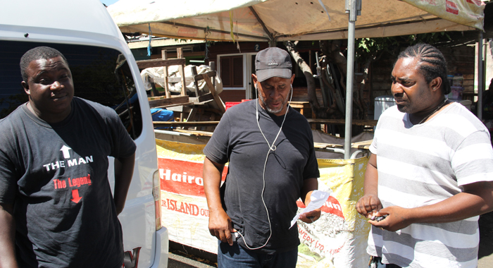 President Of Noba, Anthony &Quot;Code Red&Quot; Bacchus, Centre, And Two Bus Operators. (Iwn File Photo)