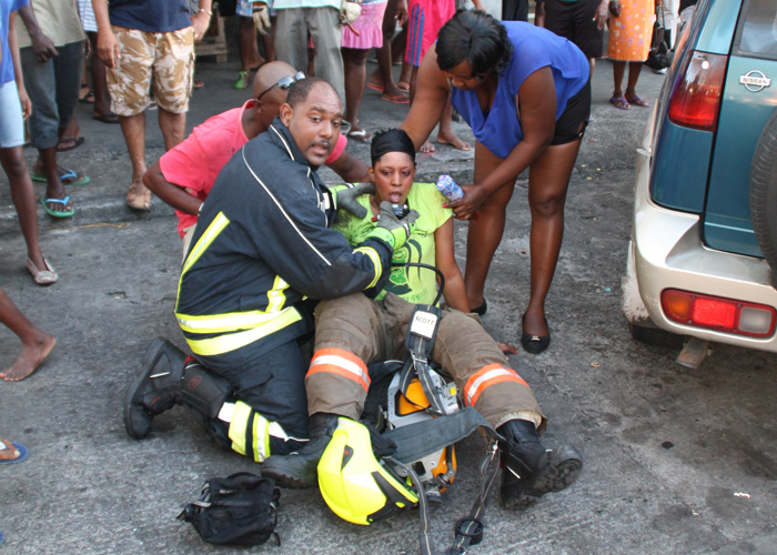 A Firefighter Assists A Colleague Who Encountered Difficulties While Fighting The Blaze On Sunday. (Photo: Karamo John/Iwn)