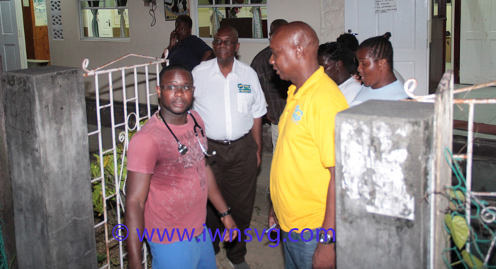 District Medical Officer, Dr. Francis Murray, Left, Opposition Leader Arnhim Eustace, And Ndp North Windward Candidate, Lauron Baptiste, And Other Persons Outside The Spring Village Health Centre, Where The Injured Who Were Initially Treated. (Iwn Photo)