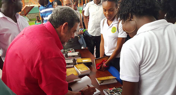 Prime Minister Ralph Gonsalves Gives Community College Students Copies Of His Books After A Question And Answer Session Organised By The College Last Week. (Photo: Lance Neverson/Facebook)
