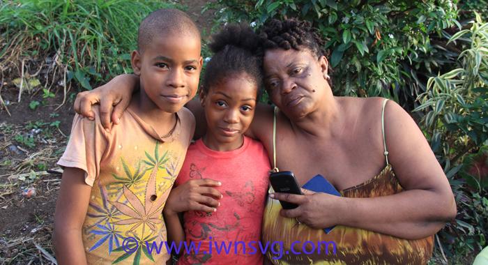 Williams' Mother, Arlene Williams, And His Children, Reihanna Nanton, 10, And Nyiha Nanton, 11 In Lowman'S Hill Sunday Evening. (Iwn Photo)