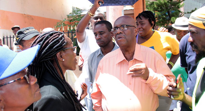 Opposition Senator, Sherlan &Quot;Zita&Quot; Barnwell Briefs Ndp Leader Arnhim Eustace On The Judgment. (Iwn Photo)