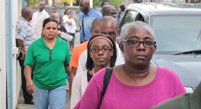 Althea Morgan, Her Daughter, Crystal, Husband, Nigel, And Police Officer Arrive At The Serious Offences Court On Friday. (Iwn Photo)