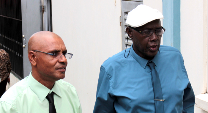 School Principal Colbert Bowens, Left, Was Wednesday Freed Of A Charge In Connection With The Death Of Seven Students. He Chats With Pastor Ehud Myers, Who Is Still Before Court On The Same Matter. (Iwn Photo)