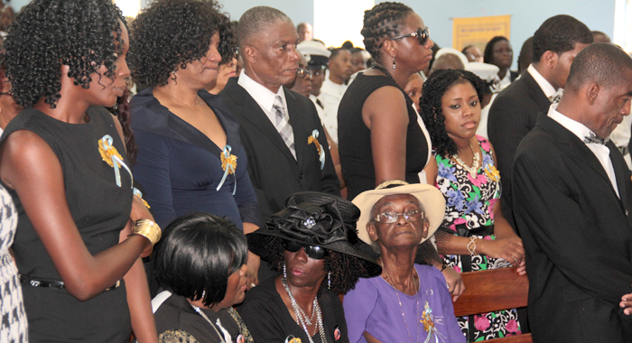 Charles' Relatives, Including His Mother, Susan Charles (In Black Hat) And Father, Douglas Pompey (Standing Right) At His Funeral In Kingstown On Saturday. (Iwn Photo)